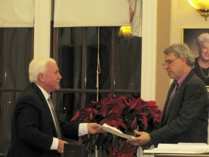Outgoing Ward 1 Alderman William Roche (L)submits his letter of resignation to City Clerk John Long