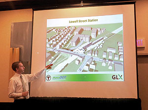 Bryant Associates' Mark Suscovich presented details to the curious crowd that gathered at the Holiday Inn last week, hoping for a clear vision of what to expect concerning the Community Path and the Green Line Extension. ~Photo by Blake Maddux
