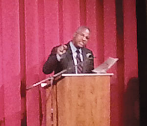 Mr. Clennon King reads Dr. King's speech at the Somerville Theatre on Monday. ~Photo by By Emmanuel Vincent.