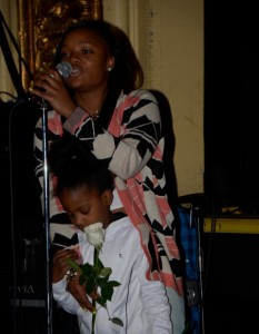 Members of the audience of all ages were encouraged to come and dedicate a rose to their loved ones. Many were dedicated to parents, grandparents, siblings and cousins – The influential ones in their lives. There were also roses for those that are no longer among us today.