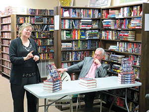 Authors Kevin Cullen and Shelley Murphy enlightened those who gathered at The Book Shop in Ball Square on the long and difficult search for one of America's most sought after criminals, Whitey Bulger. ~Photo by Blake Maddux
