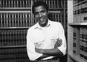 Barack Obama stands in the law library at Harvard University c.1989. Photo Courtesy of Harvard University.