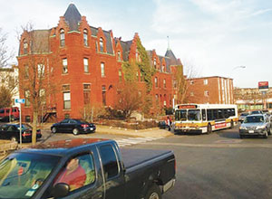 A Boston area transit bus stops in front of Obama's Somerville apartment building. © 2013 Clennon L. King