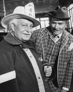 Fiedler dressed for the part of a fireman for a show skit. Skelton is dressed as Clem Kadiddlehopper.   Fiedler conducted his orchestra and played the role of a fireman in the same April 1969 Red Skelton Show visit.