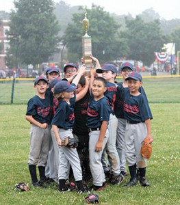 Minor league champs Boston Closet celebrate with the championship trophy.
