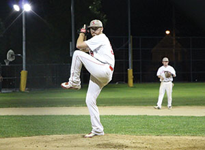 Sean Sullivan's pitching helped take the Somerville Alibrandis Baseball Club to victory in Monday night's match-up against the Brighton Braves in game 1 of the semi-final series. ~Photo by Harry Kane.